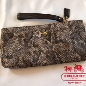 Coach NWT Madison embossed python zip clutch.